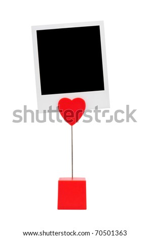Red photography holder with instant photo card isolated on a white background.