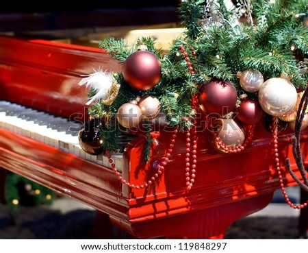 red piano with christmas decorations