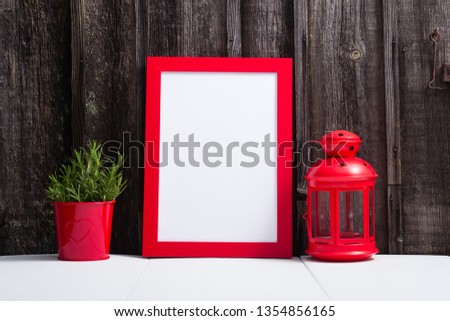 red picture frame blank, lantern, lavender decoration, white table, weathered wooden wall