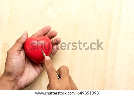 red  pillow heart in hand with Surgery concept #649351393