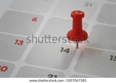 Red pin put on the calendar background in number fourteen concept of Valentine's Day. #1007067385