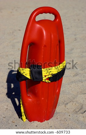 Red plastic buoyancy aid in the sand, cala bona beach, mallorca, majorca, spain