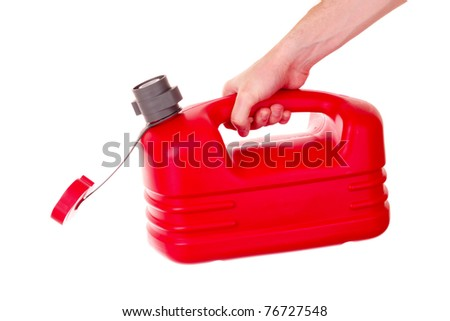 Red plastic fuel canister in hand isolated on white