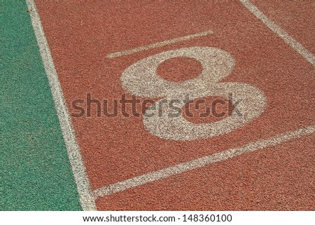 red plastic runway in a sports ground in a middle school