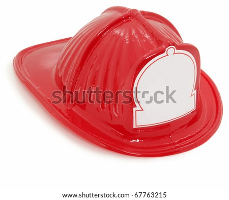 Red plastic toy fire fighter helmet over white with blank white sticker for text on front.