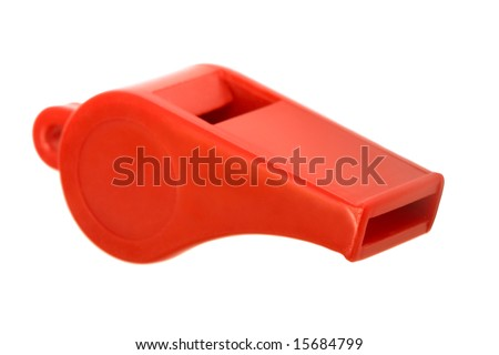 Red plastic whistle on a white background - stock photo
