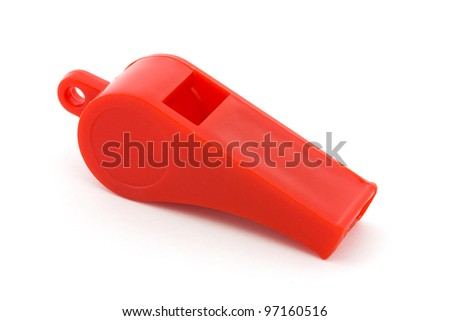 Red plastic whistle over white - stock photo