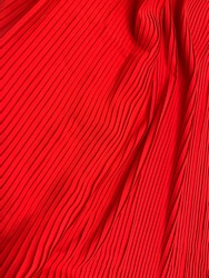Red pleated fabric isolate on white background.