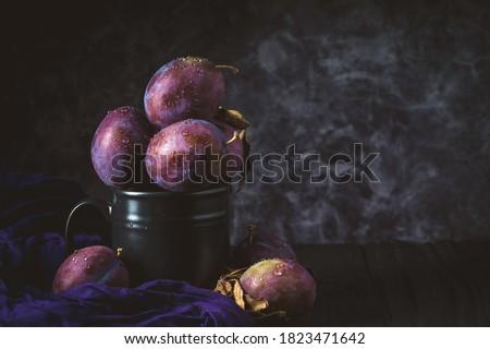 Red plum on black background