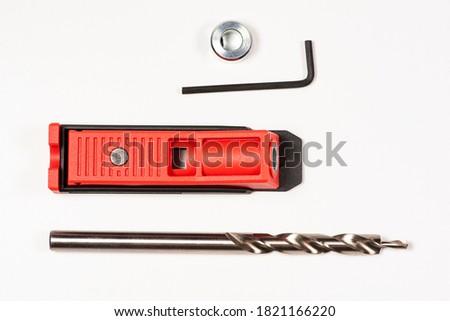 Red Pocket hole jig, dowel jig isolated image on white background
