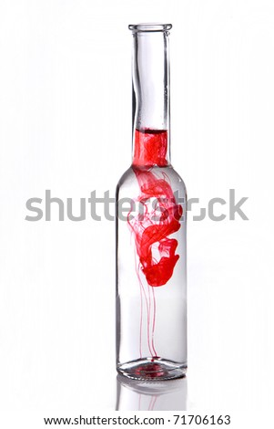 Red poison drink in bottle on white background