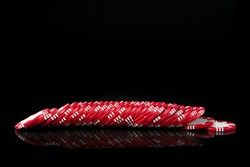 Red poker chips in a row over black background
