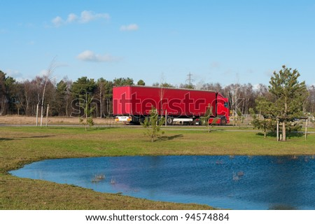 red polish truck waiting for work on an industrial area in the netherlands
