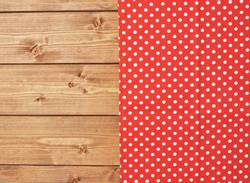 Red polka dot tablecloth or towel over the surface of a brown wooden table
