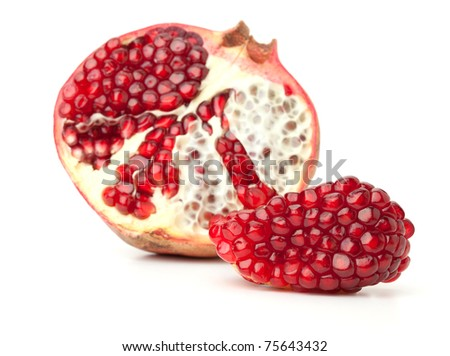 Red pomegranate fruit. Small DOF. Isolated on white background