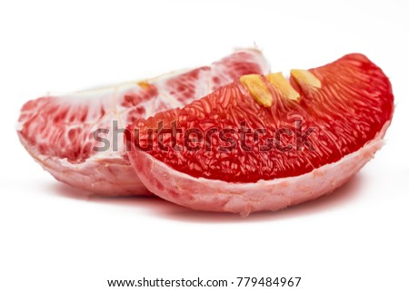 Shutterstock Red pomelo pulp with seeds isolated on white background. Thailand Siam ruby pomelo fruit. Natural source of vitamin C (antioxidants) and potassium. Healthy food for slow down aging