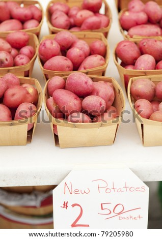 Red potatoes at farmers market - stock photo
