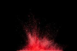 Red powder explosion on black background.