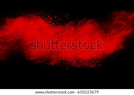 Red powder explosion on black background.