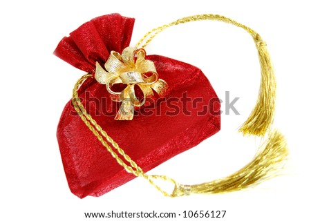 red present bag with golden tassels isolated on white - stock photo