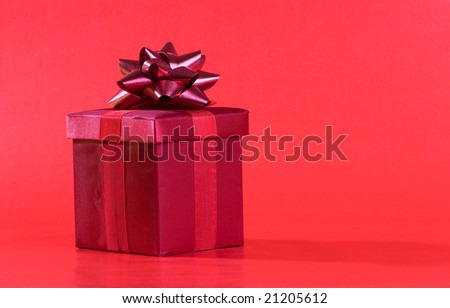 Red present box on red background
