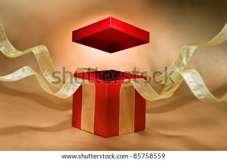 Red Present Box with open cover and yellow flying ribbon