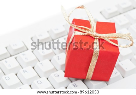 Red present on computer keyboard - christmas online shopping concept - stock photo