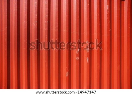 Red profiled metal wall of a cargo container