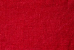 Red pure linen texture. Wrinkled linen fabric background. Light red natural linen texture background