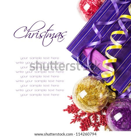 Red, purple and yellow xmas baubles with copy space
