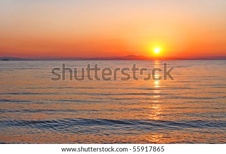 red purple sunset over the sea of japan - stock photo