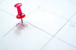 Red push pin on calendar 29th leap year day of the month