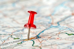 Red push pin showing location on the map. Locations marked with pin on the map, global communication network. Travel destination.