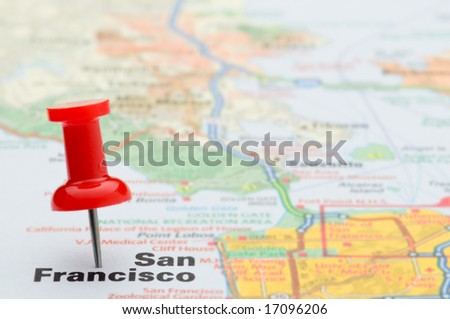 Red pushpin marking the location of the city of San Francisco on a road map, selective focus