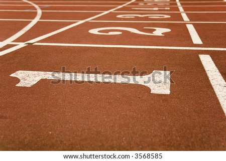 Red race track from an old olympic stadium with shallow DOF, Focus on the nr.1