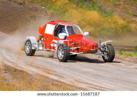 Red racing buggy on dirt track
