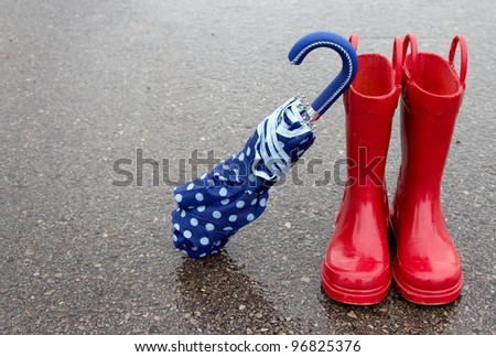 stock-photo-red-rain-boots-and-polka-dot-umbrella-on-wet-pavement-96825376.jpg