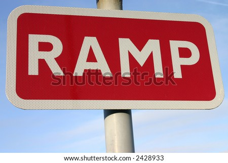 Red ramp road sign.