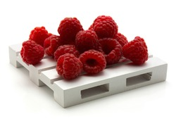 Red raspberries on pallet isolated on white background