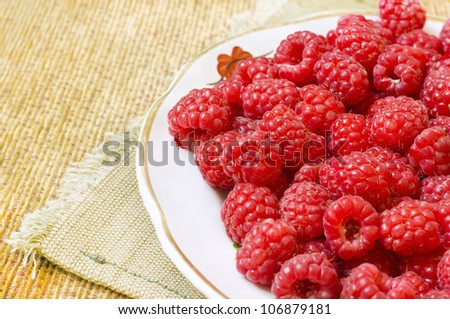 red raspberry on a table close up