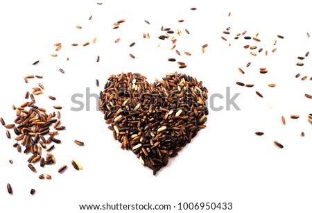Red raw rice, brown rice and mixed grains into a heart shape, healthy concept, Valentine concept isolated on white background.