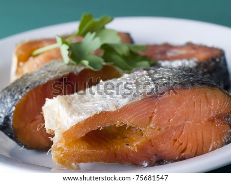 Red raw trout fish on the dish