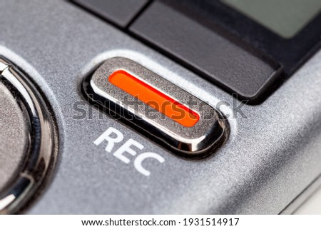 Red REC recording button on a modern pocket audio voice recorder, switch object macro extreme closeup Secretly recording, journalist or reporter equipment, simple live music recording abstract concept Photo stock ©