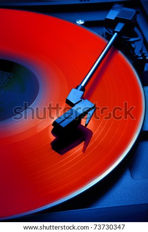 Red record shot on blue phonograph player