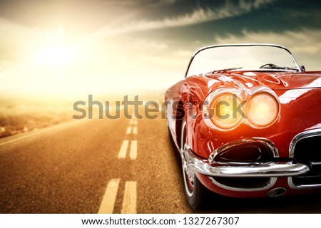 Red retro summer car on road in USA. Free space for your text.