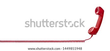 Photo of  Red retro telephone handset isolated on white background