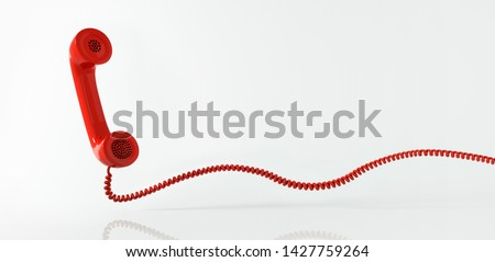 Red retro telephone receiver flying in front of a white backdrop with copy space - 3d illustration