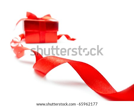 Red ribbon and red gift box on white background