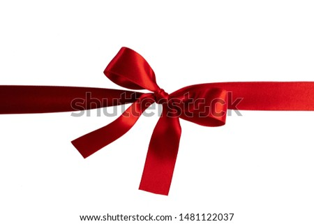 Red ribbon bow isolated on white background