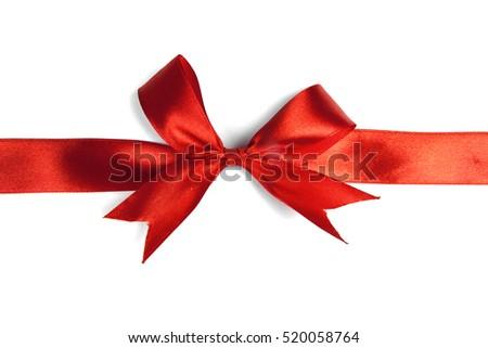 Red ribbon bow isolated on white background. Studio shot #520058764